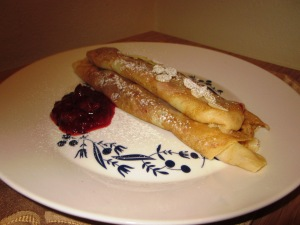 Crepes with rhubarb and raspberry compote